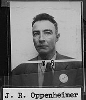 "Mug shot with ""K-6"" over it and ""J. R. Oppenheimer"" typewritten below."