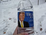 """a bottle of water with Trump&squot;s portrait and the words """"Trump Ice"""" on a blue label"""