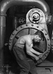 Lewis Hine Power house mechanic working on steam pump.jpg