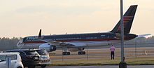 """A Boeing 757 with blue, red, and white livery, idling on a runway. This plane belongs to Trump, who nicknamed it """"Trump Force One"""" during Trump&squot;s 2016 presidential campaign."""